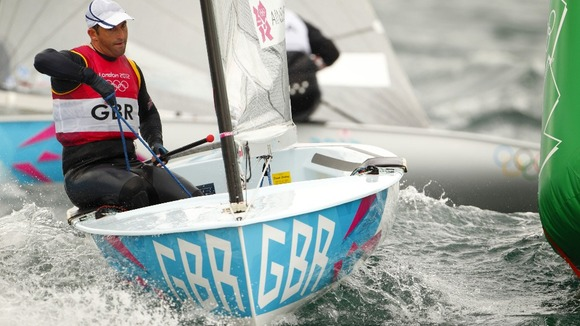 Great Britain&#x27;s Ben Ainslie rounds the first weather mark during racing in the Finn class in Weymouth today