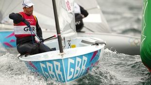 Great Britain's Ben Ainslie rounds the first weather mark during racing in the Finn class in Weymouth today