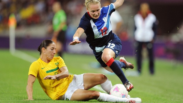 Brazil's Daiane and Britain's Little collide during their women's Group E football match at London 2012.