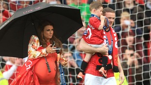 Coleen and Wayne Rooney with their son Kai when she was heavily pregnant with Klay.