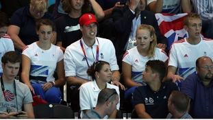 Prince William sits amongst the spectators as he watches Great Britain play Serbia during their Group B preliminary water polo match