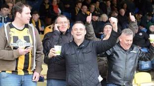 Simon Dobbin (centre) at a Cambridge United match.