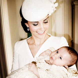 The Duchess of Cambridge holds Princess Charlotte in the Drawing Room at Sandringham House.