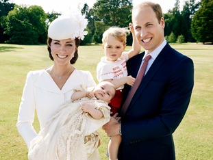 The Duke and Duchess of Cambridge with Prince George and Princess Charlotte in the garden at Sandringham House.