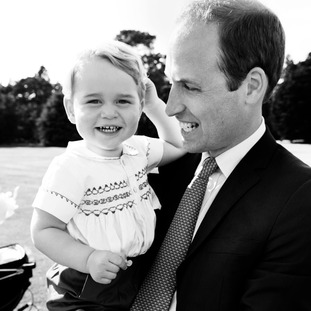 The Duke of Cambridge playing with Prince George in the garden at Sandringham House.