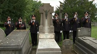 Buglers play at the graveside of police commissioner of Ypres, Pierre Vanderbraambussche, who started the tradition in 1928