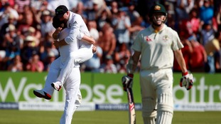 Mark Wood and Adam Lyth celebrate the wicket of Australia's Chris Rogers.
