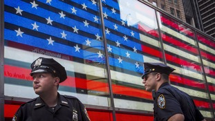 Police officers patrol Times Square, New York, the day before Independence Day