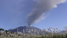 Ash and smoke are emitted from the volcano Mount Raung