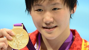 China's Shiwen Ye with her gold medal after winning the women's 200m individual medley final at the Aquatics Centre on Tuesday.