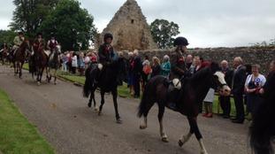 The cavalcade ride past Ferniehirst Castle
