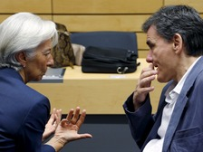 International Monetary Fund (IMF) Managing Director Christine Lagarde talks to Greek Finance Minister Euclid Tsakalotos.