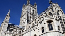 A 15-year-old boy has been arrested on suspicion of rape in the grounds of Gloucester Cathedral.
