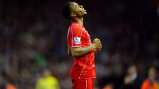 Raheem Sterling on pitch in Liverpool strip