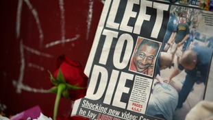 A picture of Garner is seen on a newspaper at his memorial in Staten Island