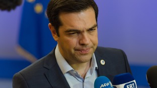 Greek Prime Minister Alexis Tsipras talks to the press at the end of the Greece - EU summit.