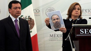 Mexico's Attorney General Arely Gomez Gonzalez shows a mugshot of drug lord Joaquin 'El Chapo' Guzman.