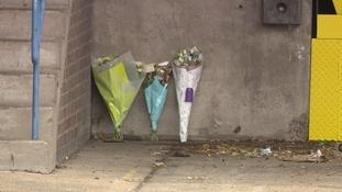 Flowers left at the scene.