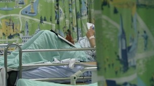Anonymous person in hospital bed