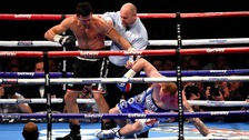 Carl Froch knocks down George Groves in front of 80,000 fans at Wembley stadium