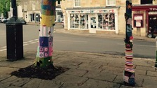 Knitters yarn bomb Oundle to brighten the place up.