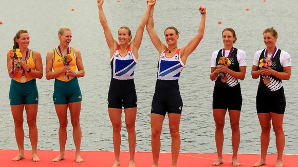 Great Britain's Helen Glover (centre left) and Heather Stanning (centre right) celebrate.