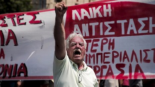 An anti-austerity protester marches in Athens.
