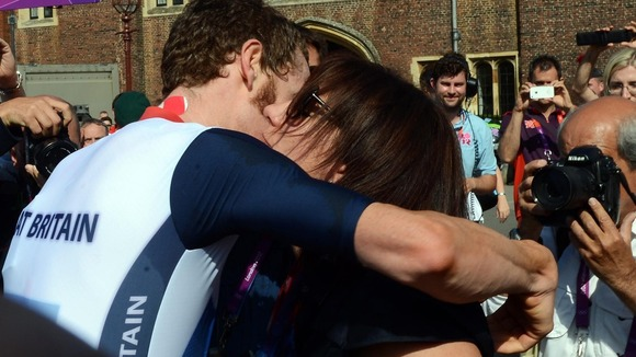Bradley Wiggins celebrates with his wife Cath after winning the Men's Individual Time Trial