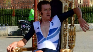 Bradley Wiggins sits on his throne after winning a gold medal for Team GB