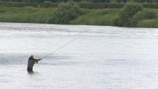 man fishing on the tweed
