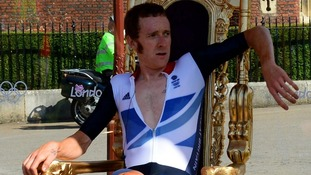 Bradley Wiggins sits on his throne after winning the Men's Individual Time Trial