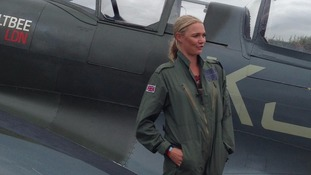 Jodie Kidd poses by a plane