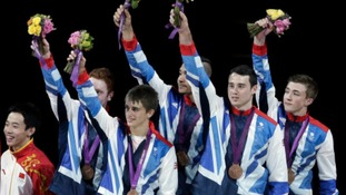 Kristian Thomas wins bronze with his gymnastic team on Monday