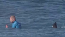 Surfer Mick Fanning was attacked by a shark mid-competition.