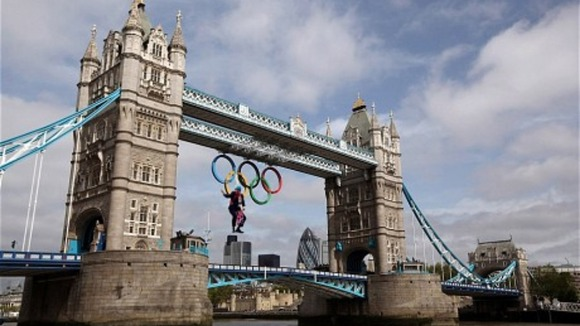 Dangling from Olympic rings on Tower Bridge.