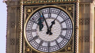 Hanging from the clock face on the tower that houses Big Ben.