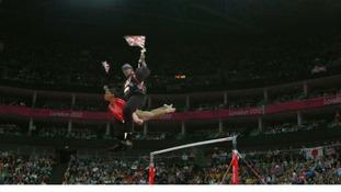 Riding on an Olympic gymnast.