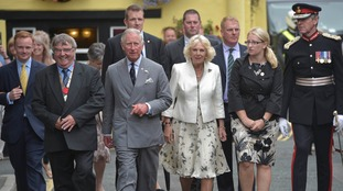 Charles and Camilla surrounded by local dignitaries in Padstow