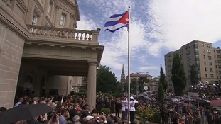 The Cuban flag is raised outside the Embassy in Washington today.