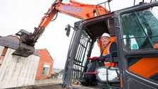 Councillor Paul Watson in a mini digger