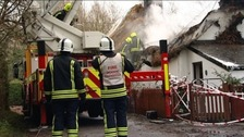 Fire service at scene of thatched cottage fire
