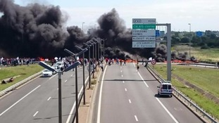 Burning tyres on the approach to the Eurotunnel terminal