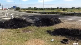 Tyres were burned on the motorway approaching the terminal in Calais