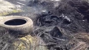 The remains of the burnt tyres