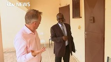 Kambanda shows John Ray around his Mali prison complex.