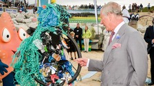Prince Charles meets a man apparently made of rubbish.
