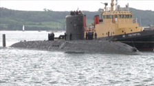Two electricians were accidentally sealed inside a ballast tank in a Plymouth submarine.