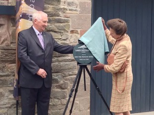 Princess Anne unveiling the plaque at the official opening of the Lakes Distillery