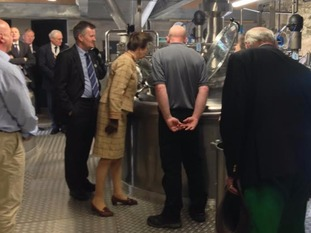 The Princess Royal inspecting mash tun which starts the whisky brew at Lakes Distillery