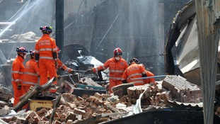 Emergency services at the scene of the blast.